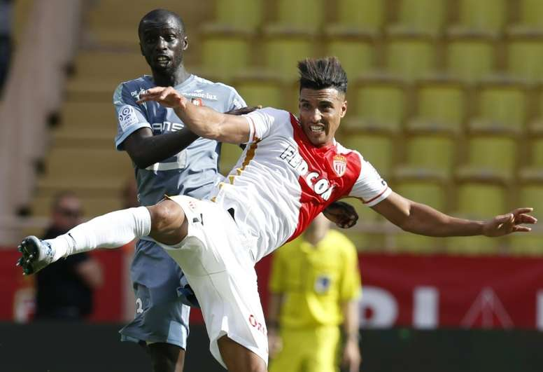 6202b1a7b72c Pin Monacos midfielder Nabil Dirar (R) clashes with Rennes defender Cheik  Mbengue during a French