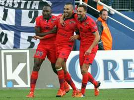Ajaccios forward Khalid Boutaib (C) is congratulated by teammates after scoring a goal during the L1 football match against Bastia on November 22, 2015, at the Armand Cesari stadium