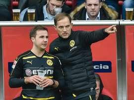 Dortmund's head coach Thomas Tuchel gives Dortmund's midfielder Mario Goetze instructions during the German first division Bundesliga football match between FC Ingolstadt 04 and Borussia Dortmund in Ingolstadt, southern Germany, on October 22, 2016