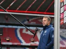 Bayern coach Flick bemoans lack of fans at 'special' Dortmund clash. AFP