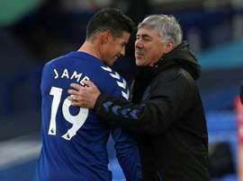Everton midfielder James Rodriguez is congratulated by boss Carlo Ancelotti. AFP