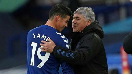 Everton midfielder James Rodriguez is congratulated by boss Carlo Ancelotti. AFP