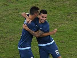 Argentina player Angel Correa (R) celebrates after scoring against Algeria in Rio de Janeiro, Brazil, on August 7, 2016