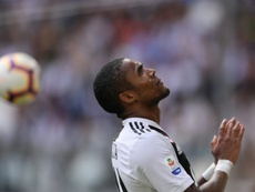 Winger Douglas Costa looks to the heavens after missing a goalscoring opportunity. AFP
