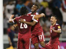 Qatars Sebastian Soria (L) is congratulated by teammate Ismaeel Mohammad (C) after he scored a goal during a 2018 World Cup football qualifying match against Hong Kong in Doha on March 24, 2016