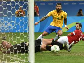 Gabriel (C) of Brazil kicks the ball to score against Denmark during the Rio 2016 Olympic Games Group A football match