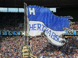 Hetha Berlin supporters cheer prior to a match on August 6, 2011