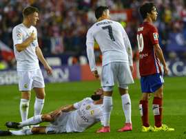 Real Madrids defender Dani Carvajal (down) reacts to an injury on October 4, 2015