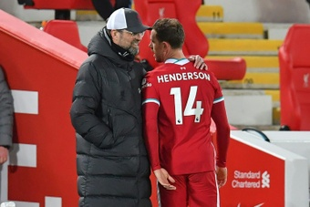 Henderson will continue to be a part of LIverpool for the coming seasons. AFP