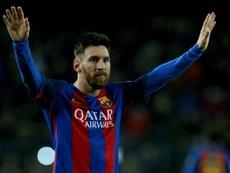 Barcelonas forward Lionel Messi celebrates his goal on December 18, 2016