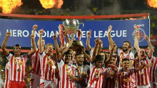 Atletico de Kolkata players celebrate with the trophy. AFP