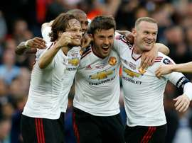 Manchester Uniteds Daley Blind (L), Ashley Young (2nd L), Michael Carrick (2nd R) and Wayne Rooney celebrate on the final whistle after extra time in the English FA Cup final football match at Wembley stadium in London on May 21, 2016