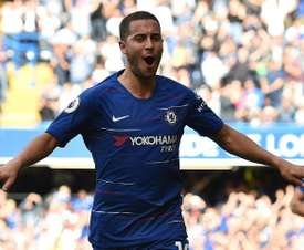 Eden Hazard celebrates one of his three goals against Cardiff. AFP