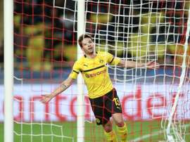 Guerreiro scored twice to secure top spot for Dortmund. AFP
