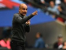 Pep Guardiola entered Premier League history with a domestic treble. AFP