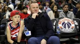Le fils de Rooney pourrait jouer à Manchester City. AFP