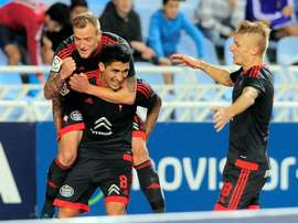 Celta Vigos midfielder Pablo Hernandez (C) celebrates a goal with teammates John Guidetti (L) and Daniel Wass (R) during the Spanish league football match Real Sociedad vs Celta Vigo in San Sebastian on October 31, 2015
