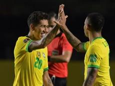 Roberto Firmino (L) scored the decisive goal for under-par Brazil. AFP