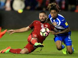 Clint Dempsey of the United States scores one of his three goals in a 6-0 thrashing of Honduras. AFP
