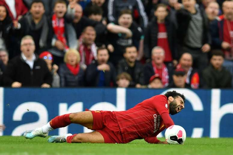 Liverpool's Salah escapes with twisted ankle. AFP