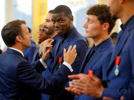 Emmanuel Macron presented Paul Pogba with the Legion of Honour order of merit in 2019. AFP