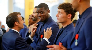 Emmanuel Macron presented Paul Pogba with the Legion of Honour order of merit in 2019. AFP