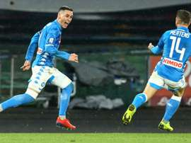 Napoli beat Lazio to keep sight of Juventus.