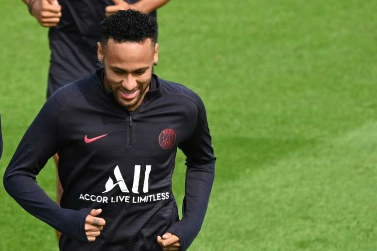 Neymar takes part in PSG training while his departure made headlines. AFP