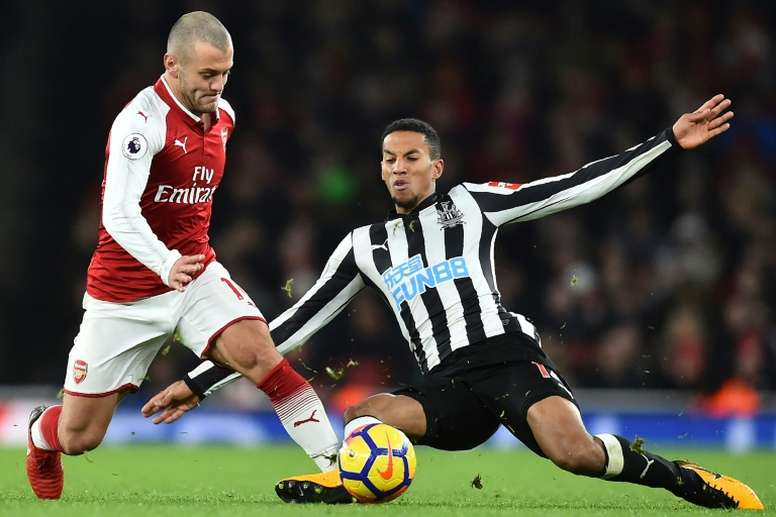 Isaac Hayden challenges Jack Wilshere, now of West Ham. AFP