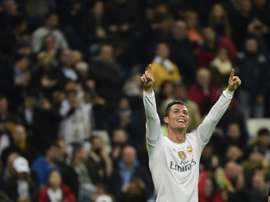 Real Madrids forward Cristiano Ronaldo celebrates after scoring during a UEFA Champions League Group A football match against Malmo at the Santiago Bernabeu stadium in Madrid on December 8, 2015