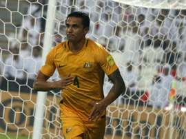 Tim Cahill celebrates scoring a goal during their 2018 World Cup qualifying match against UAE. AFP