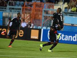 Pirates players celebrate a goal during the second leg of the semi final of the 2015 CAF - Confederation of African Football Cup - between Egyptian team Al Ahly and South African team Orlando Pirates on October 4, 2015 at Suez Stadium
