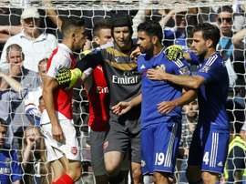 Arsenals Brazilian defender Gabriel (L) and Chelseas Brazilian-born Spanish striker Diego Costa (2nd R) are separated by Arsenals Czech goalkeeper Petr Cech (C) as they clash during the English Premier League football in Lond on September 19, 2015