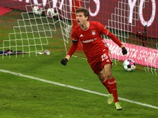 Thomas Muller gave Bayern a draw in a six goal thriller with Leipzig. AFP