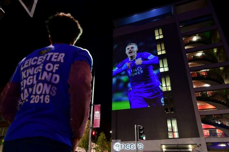 A Leicester City football fan celebrates the teams unlikely victory in the 2016 Premier League title race