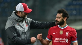 Liverpools Mohamed Salah (right)has tested positive for coronavirus. AFP