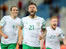 Irelands Daryl Murphy (C) celebrates scoring with teammates John OShea (L) and Stephen Quinn on September 5, 2016