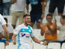 Olympique de Marseilles French midfielder Remy Cabella celebrates after scoring during the French Ligue 1 football match Olympique de Marseille versus Lorient on August 26, 2016 at the Velodrome stadium in Marseille, southern France