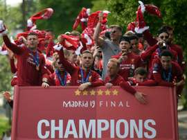Liverpool eye Premier League title as barometer of success. AFP