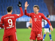 Lewandowski and Muller both got on the scoresheet in the easy win at Schalke. AFP