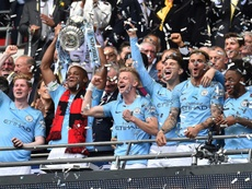 Vincent Kompany lifts the FA Cup after a comfortable 6-0 win over Watford. AFP