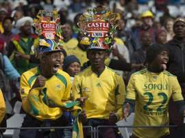 Fans of South Africas football team, Bafana Bafana cheer for their team on June 16, 2015, in Cape Town