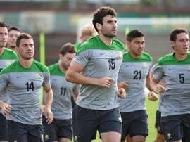 Australian Socceroos captain Mile Jedinak (centre) jogs with teammates during a training run in Vitoria on June 11, 2014