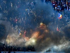 Romania were punished by UEFA for the behaviour of their supporters during a game v Serbia. AFP