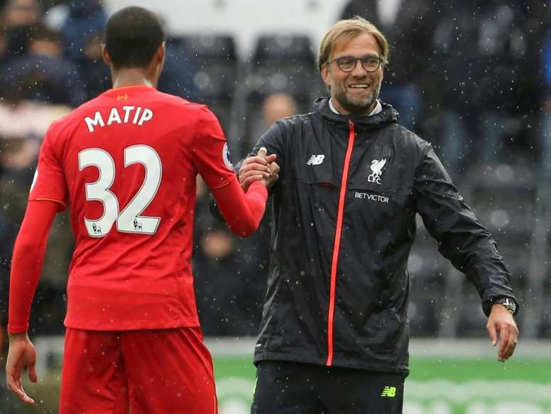Matip (L) may face a month out. AFP