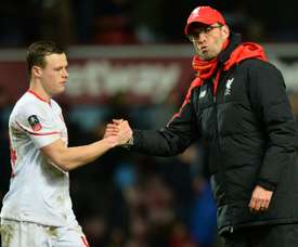 Liverpool Jurgen Klopp shakes hands with Brad Smith after a match. AFP