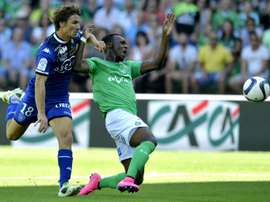 Bastias midfielder Yannick Cahuzac (L) clashes with Saint-Etiennes forward Jean-Christophe Bahebeck during a French L1 football match on August 30, 2015, at the Geoffroy Guichard Stadium in Saint-Etienne, central France