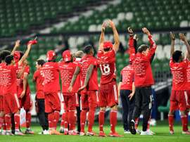 Lewandowski hopes fans can return soon after winning the Bundesliga behind closed doors. AFP
