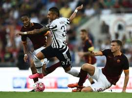Pereyra is challenged by Roma's Edin Dzeko. AFP