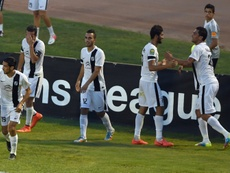 Tunisias CS Sfaxien players celebrate after scoring a goal during a CAF Champions League match in Tunis